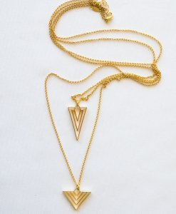 A long chain is double geometric and gilt charm